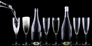 Anagram Events Australia - see our amazing feedback - stock image of sparkling wine being poured into wine glasses